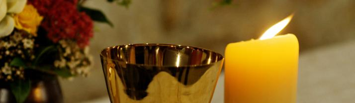 Candle and chalice